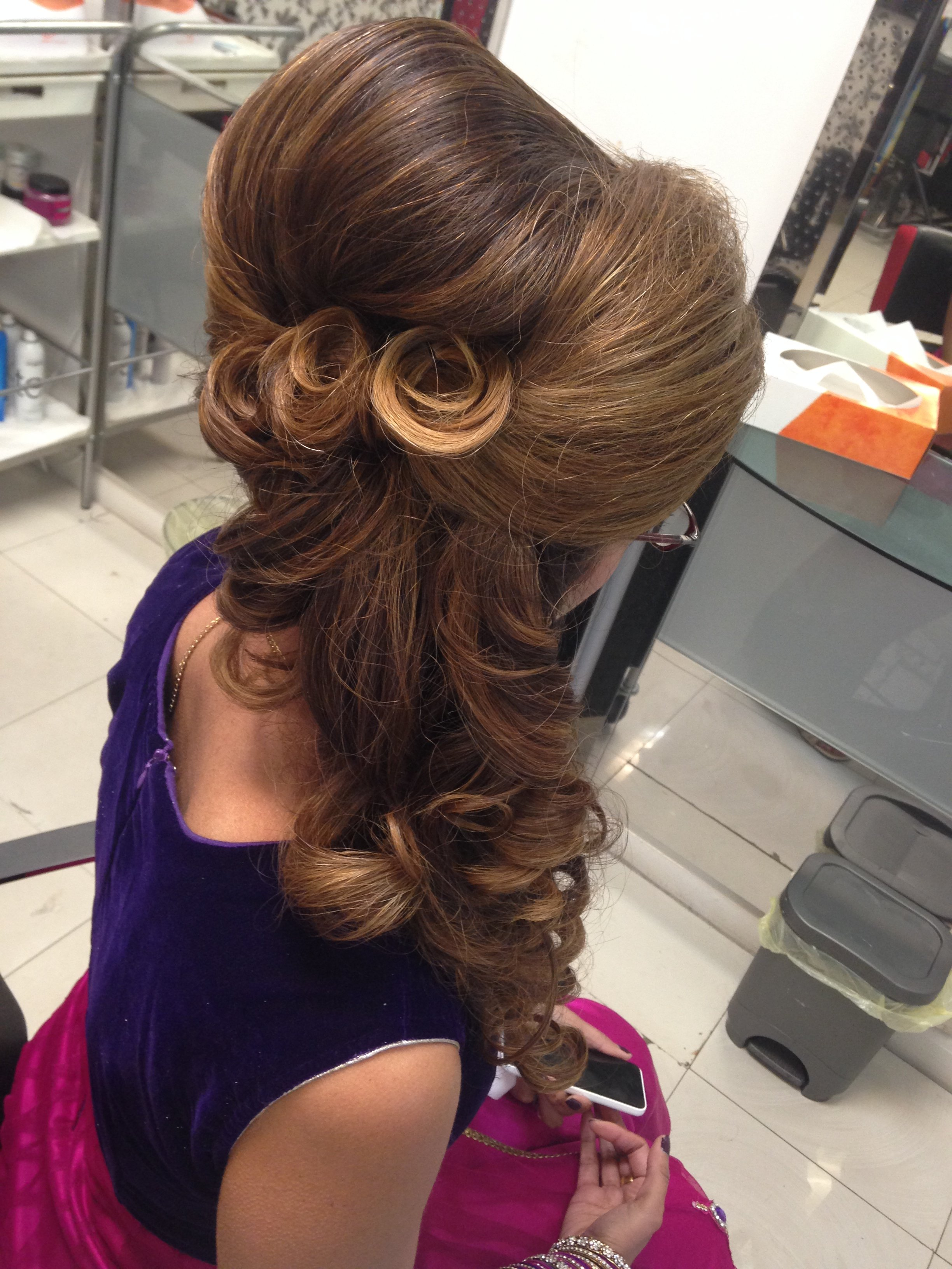 Party Hairstyle With Swirly Details And Beehive
