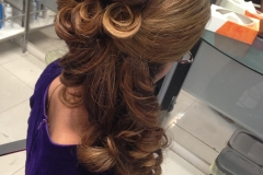 party-hairstyle-with-swirly-details-and-beehive
