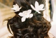 curled hair with flowers bridal hairstyle beach wedding