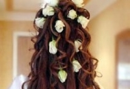 bridal hairstyle all over curls with flowers