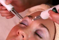 Electro buds on brow bone during a CACI treatment