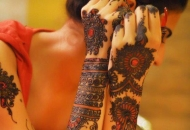 Asian Bride getting ready while Henna/Mehndi dries
