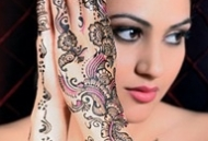 Asian Bride displaying coloured Henna/Mehndi Art on hands