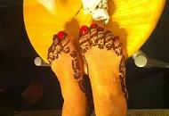 Delicate henna-mehndi application on feet