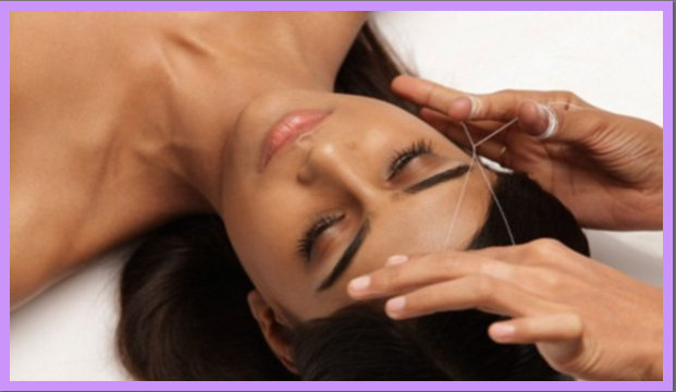 threading : Women having her eye brows threaded