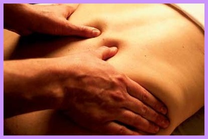 Therapist using kneading motion on the back in a deep tissue massage
