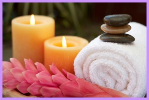 Candles, towels & hot stones in a massage therapy room